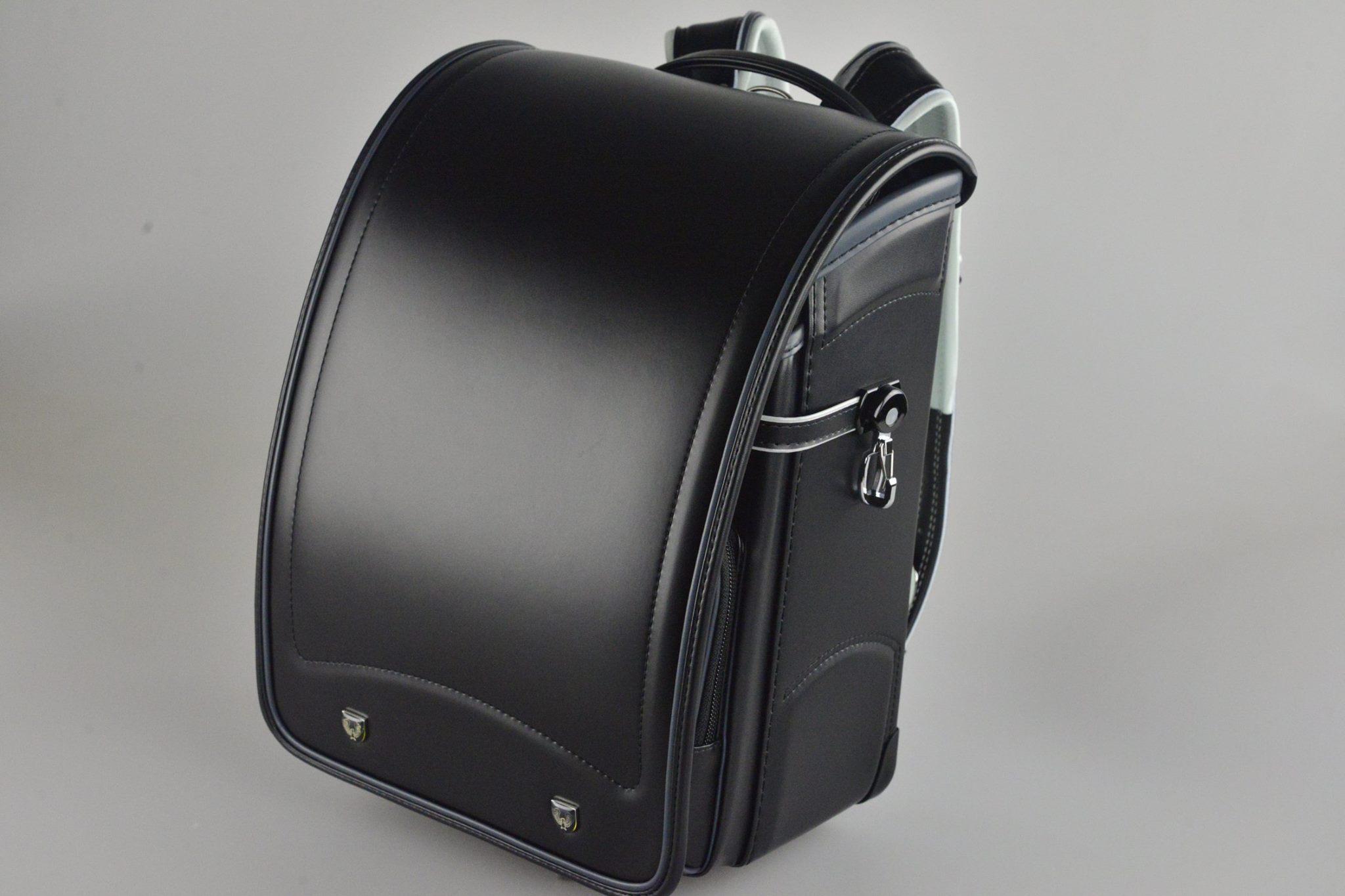 日本協和製黑色滾銀灰色邊自動上鎖小學生書包