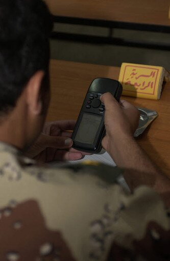An Iraqi Army lieutenant learns how to use a handheld GPS device Poster Print by Stocktrek Images (22 x 34) thumbnail