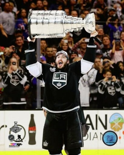Drew Doughty with the Stanley Cup Game 5 of the 2014 NHL Stanley Cup Finals Photo Print (20 x 24) b532737d598870c1927b3c1bb4600fc7