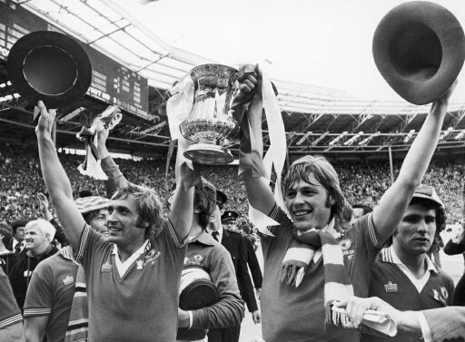 England Fa Cup 1977 Njimmy Greenhoff (Left) And Brian Greenhoff Of Manchester United Celebrate Their Victory Over Liverpool FC In The Fa Cup Final 21 May 1977 Poster Print by (18 x 24) 18f400cc296c7f655f7ed5753f3325b3