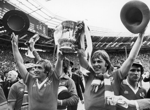 England Fa Cup 1977 Njimmy Greenhoff (Left) And Brian Greenhoff Of Manchester United Celebrate Their Victory Over Liverpool FC In The Fa Cup Final 21 May 1977 Rolled Canvas Art - (24 x 36) 3f1a68136067d9c8ebbd75041a2af332
