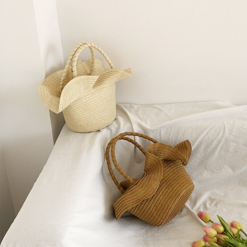 木耳邊度假草編包女韓版度假海邊沙灘包波浪邊手提編織草包水桶包1入