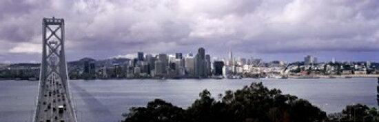 Bridge across a bay with city skyline in the background Bay Bridge San Francisco Bay San Francisco California USA Poster Print (36 x 12) 0