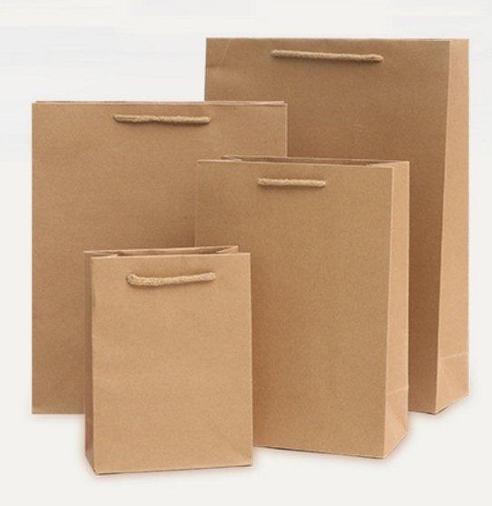服飾包裝 包裝袋 牛皮紙袋 特大 絕非小的喔 !! 厚的 絕對 比別人厚 批發價 供應 現貨喔 100