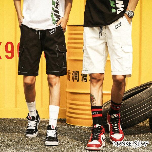 《MonkeyShop》【M1018】YUX字母反車線造型彈性鬆緊休閒短褲-2色