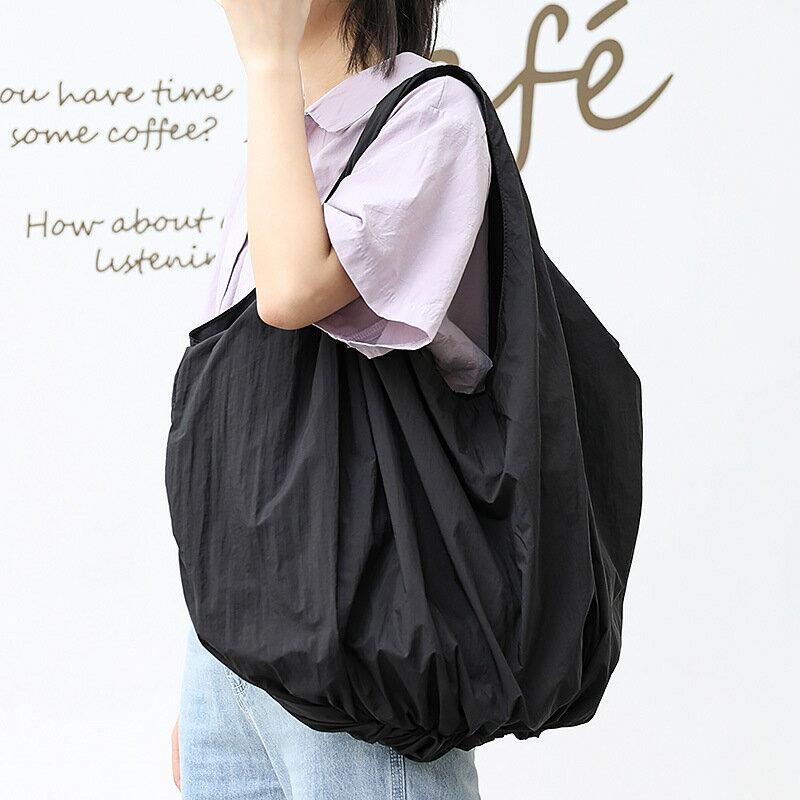 日系時尚慵懶腋下包港風花苞挎兜帆布手提包網紅純色單肩女包bags