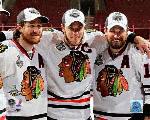 Chicago Blackhawks Captains Jonathan Toews Duncan Keith & Patrick Sharp Celebrate Winning the 2010 Stanley Cup Photo Print (16 x 20) a5495cfbf7fb26cac5c761d170a79ad5