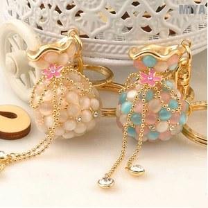 【MiYA米亞】錢包袋貓眼石包包掛飾鑰匙圈(可愛造型飾品水鑽隨身吊飾裝飾精品白色彩色扣釦)