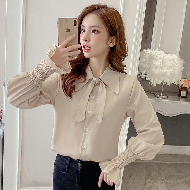 白襯衫女設計感小眾2020春裝新款韓版蝴蝶結單排扣系帶喇叭袖上衣1入
