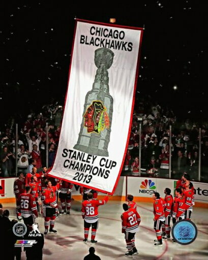 The Chicago Blackhawks raise their 2013 Stanley Cup Championship Banner Photo Print (16 x 20) 809f94d8e6b37ee3d93fa82d24250dff