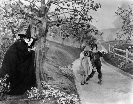 Wizard Of Oz 1939Nmargaret Hamilton As The Wicked Witch Of The West Judy Garland As Dorothy And Ray Bolger As The Scarecrow Poster Print by (18 x 24) d06cf37393ce58346e4d4a469bf1c0a8