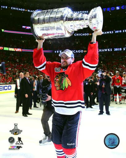 Marcus Kruger with the Stanley Cup Game 6 of the 2015 Stanley Cup Finals Photo Print (16 x 20) 4b04d39dc826e1b26950030529250436