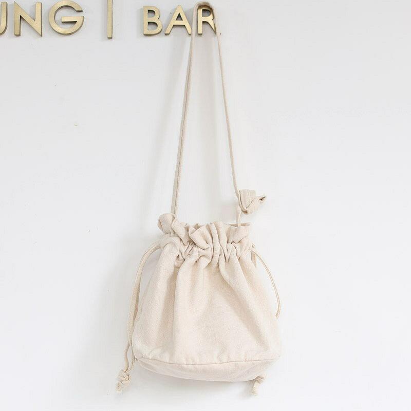 韓版網紅抽帶水桶包休閒簡約復古斜挎女包可愛森系文藝帆布單肩包
