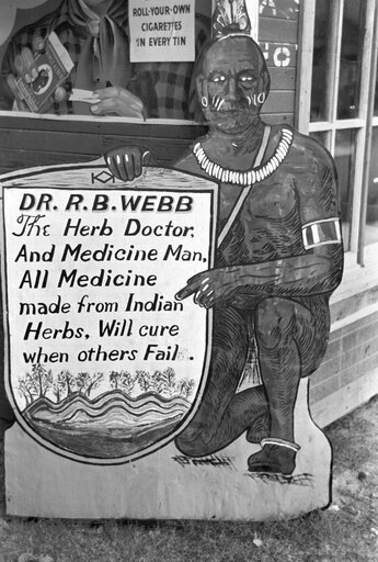 Medicine Man 1938 Na Native American Medicine Sign Advertising An Herbal Doctor In Pine Bluffs Arkansas Photograph By Russell Lee In September 1938 Rolled Canvas Art - (24 x 36) f34fa2b4c095777dbe3ef92079e414f8