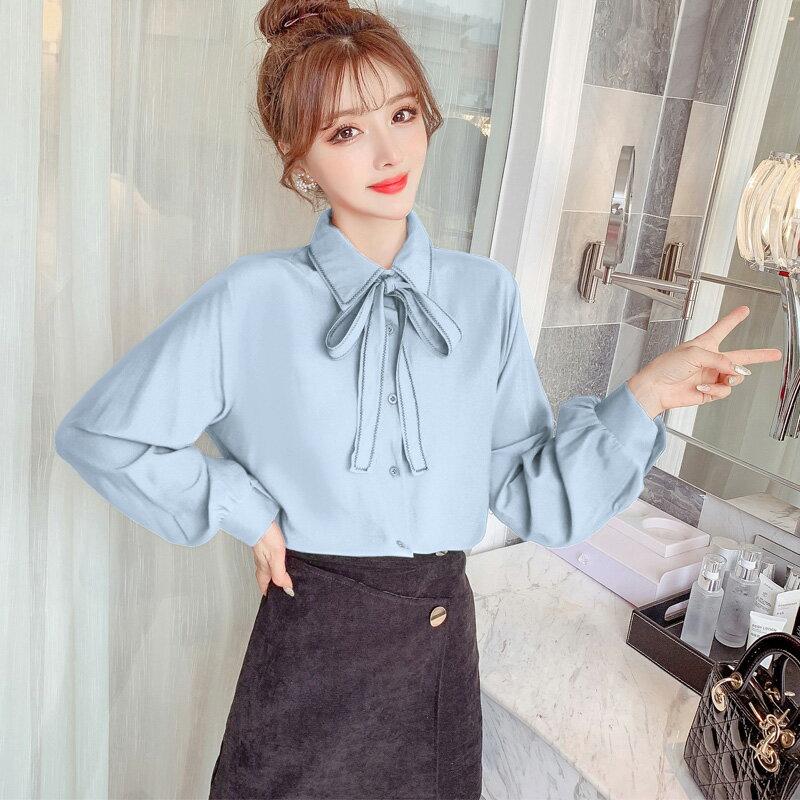 襯衫女設計感小眾2020春裝新款韓版Polo領蝴蝶結系帶單排扣上衣潮1入