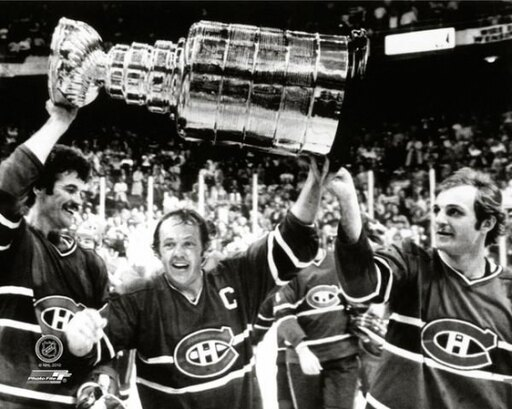 Yvan Cournoyer #12 hoist the Stanley Cup Trophy with help from teammates Yvon Lambert #10 and Guy Lafleur #10 of the Montreal Canadiens after defeating the Boston Bruins at the Boston Garden on May 25 1978 Photo Print (16 x 20) c6db15624fd1d1195603a2d329