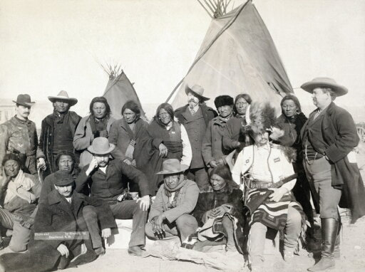 Pine Ridge Reservation Ngroup Portrait Of Lakota Sioux Chiefs And White US Officials Including Buffalo Bill Cody (Standing Center) In Front Of Tipis On The Pine Ridge Reservation In South Dakota Photo c3c92a65df625dd5f3eb9a385e8d45f2